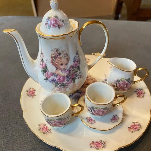 Vintage miniature tea set cherub girl